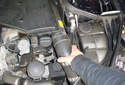 Remove the left side engine snorkel pull by pulling it straight off of the air intake tube.