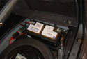The battery is located on the right side of the trunk.