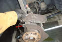 Front Wheel Speed Sensor Remove the heat shield that the fasteners hold down by lifting straight up.
