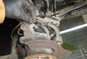 Front Wheel Speed Sensor Pull the sensor out of the mounting bore in the spindle by pulling it straight up.