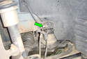 Front Brake Hose Thread the other end of the metal brake line fitting (green arrows) from the rubber brake hose.