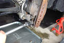 If you do not have a ball joint removal tool, use a forked splitter to separate the ball joint from the spindle.