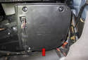 Next, the lower blower motor cover (red arrow) has to be removed.
