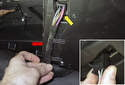 Start by pulling the wiring harness out of the retaining tabs (red arrow).
