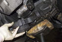 Once the fasteners have been removed, remove the mount from the transmission.