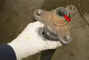 Before installing, apply a small amount of NLGI Grade 2 longlife grease to the driveshaft ends (red arrow).