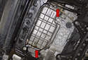 The first thing you have to do is detach the steel lines from the sides of the oil pan (red arrows).