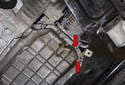 Working at the right side of the oil pan, remove the two E10 Torx fasteners (red arrows).