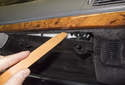 Use a plastic trim panel tool and lever the trim piece off the instrument panel.