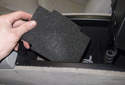 Next, remove the foam insulation at the bottom of the storage compartment.
