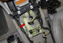 This photo shows the shift selector module (red arrow) with the center console removed.