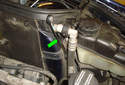 Using a 16mm wrench (green arrow) hold the front upper control arm fasteners still while loosening the front fastener pointed out inPicture 3.