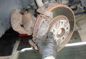 Front Brake Rotor Remove the outer brake pad from the caliper mounting bracket.