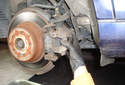 Remove the caliper from its brake caliper bracket.