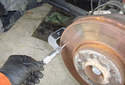 Measure the brake rotor thickness in at least 10 spots around the rotor.