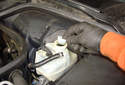 Remove the filer screen from the fill opening in the brake fluid reservoir.