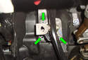 Working at the firewall behind the brake pedal, remove the three 13mm fasteners (green arrows).