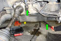 Using a long drift tap or pry bar (green arrows) as your special tool, tap the axle shaft out of the front differential.