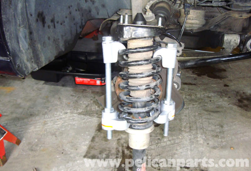 Mercedes benz w211 front shock absorber replacement 2003 for Mercedes benz spring compressor