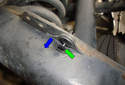 To remove the plastic rivet pull the center pin (green arrow) into the direction of the blue arrow, then you can pull out the entire plastic rivet.