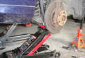 Before removing any fasteners support the lower control arm with a jack.