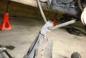 Remove the parking brake cable from its mount in the lower control arm.