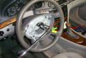 Using a 10mm Allen head socket on a breaker bar, remove the steering wheel fastener.