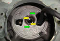 This picture illustrates a close up look at where the steering wheel is mounted to the steering column shaft.