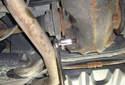 Remove the 14mm drain plug.