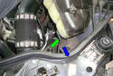 Rotate the coolant reservoir slightly to expose the coolant level sensor on the underside of it.