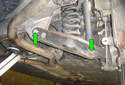 Remove the two fasteners (green arrows) on the lower control arm but do not pull the fasteners out yet.