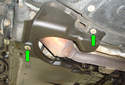 This photo illustrates under the left side of the car behind the front tire looking up at the transmission.