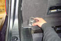 Remove both tie down brackets from the trunk.