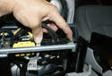 Unplug the final connector on the left side of the seat by squeezing the locking tabs on each side of the electrical connector and pulling it away from the power seat assembly.
