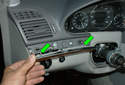 There are two pins (green arrows) for mounting the small wood trim strip so lever up on each side of it.