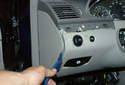 Using a plastic prying tool lever off the dashboard left side panel.