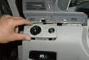 Lift up on the headlight switch to unseat it from the lower left dashboard panel and pull it out.