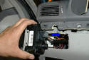 Then, with the locking lever fully released, pull the electrical connector in the direction of the blue arrow.