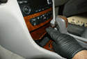 This picture illustrates the center console of the dashboard by the shifter.