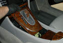 Slide the shifter bezel forward to release it from the center console.