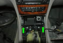 Lift up on the two corners of the ash tray (green arrows) to unclip it from the center console.