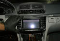 Slide the radio/navigation unit toward you to expose the electrical and fiber-optic connectors at the back of the unit.