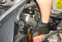 Pull the lower radiator hose out of the radiator hose neck.