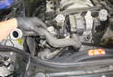 Lift the lower radiator hose out of the engine compartment.