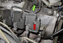 Then, remove the T30 Torx fastener (red arrow).