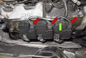 Working at the right side valve cover, disconnect the ignition coil electrical connectors by pressing the release tab and pulling them straight out (red arrows).