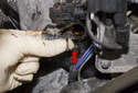 Pull the camshaft sensor sealing O-ring (red arrow) out of the cylinder head.