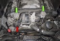 The secondary air valves are located at the left and right corners of the engine (green arrows).