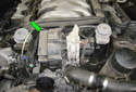 Secondary air pump testing: The secondary air pump is located at the front of the engine (green arrow).