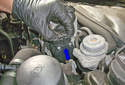 Secondary air pump testing: Next, disconnect the secondary air pump electrical connector (blue arrow) by squeezing the release tabs and pulling it straight off.